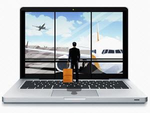 Businessman on laptop keyboard looking at starting plane