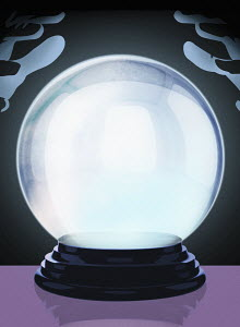 Hands above glowing crystal ball
