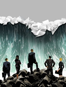 Businesspeople looking at breaking wave with papers
