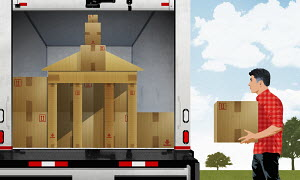 Man loading moving van with cardboard boxes in shape of university building
