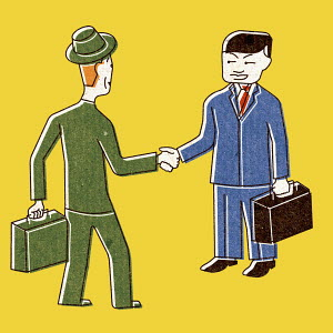 Caucasian businessman shaking hands with Chinese businessman