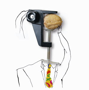 Man with clamp head trying to crack walnut