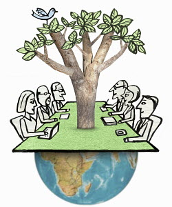 Business meeting with tree growing out of globe