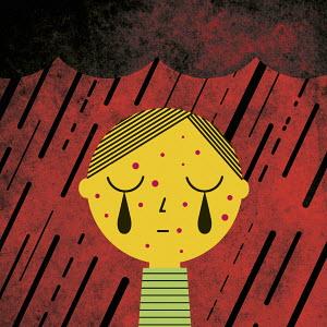 Boy crying in the rain