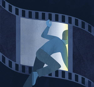 Man climbing through film strip