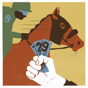 Hand holding banknotes at a horse race