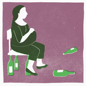 Pregnant woman surrounded by wine bottles