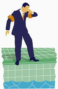 Businessman standing by swimming pool