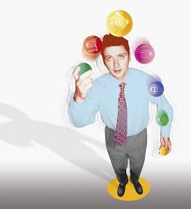 Businessman juggling balls