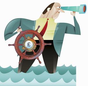 Businessman using steering wheel with British pound symbol