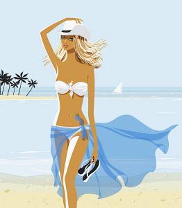Sexy woman in bikini and cowboy hat on beach