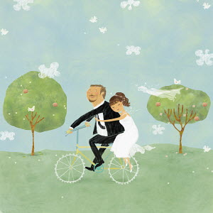 Bride and groom on bicycle in park