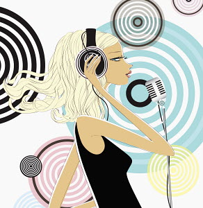 Woman wearing headphones and singing into microphone