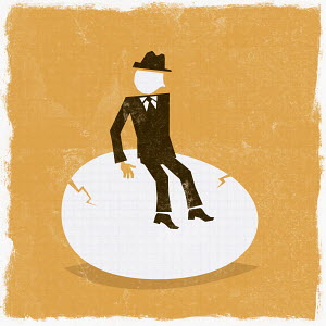 Businessman on cracked egg