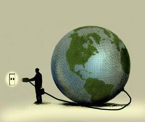 Man connecting globe to wall socket