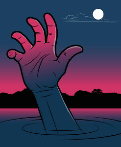 Hand of a man drowning in a lake at night