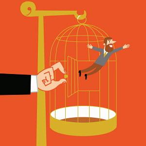 Hand releasing man from birdcage