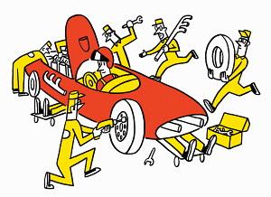 Mechanics maintaining racing car