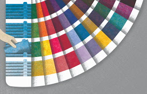 Hand choosing from fanned out color sample