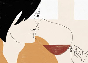 Woman smelling at red wine glass