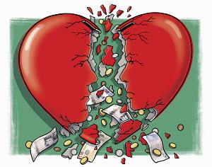 Money falling out of broken heart money box