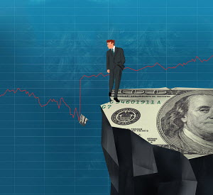Businessman on cliff looking at broken piece of dollar bill in line graph