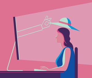 Hand emerging from computer screen putting hat on woman's head