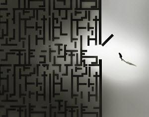 Woman entering dark maze