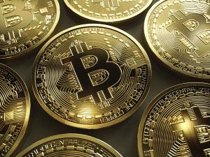 Close up of shiny new gold bitcoins