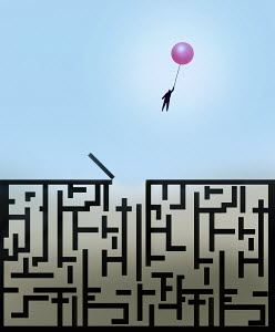 Man escaping from maze holding balloon