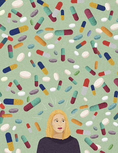 Anxious woman surrounded by lots of pills