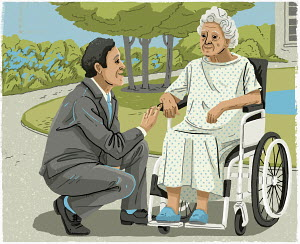 Man in suit talking to elderly woman in wheelchair