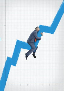Businessman embracing rising line graph