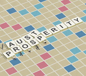 Business people replacing austerity with prosperity on word game board