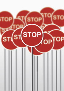 Lots of signposts saying stop