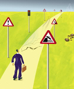 Businessman standing on dangerous cracking road