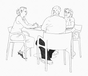 Three people sitting at table discussing