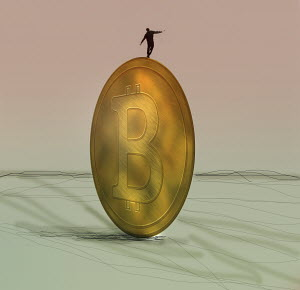 Businessman balancing on bitcoin