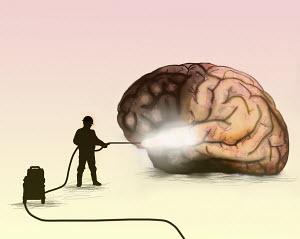 Man washing brain with pressure washer
