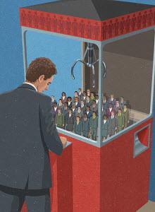 Businessman choosing workers in grabber game
