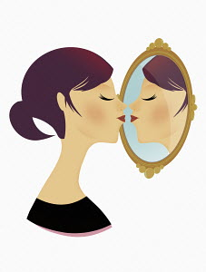 Woman posing as astrology sign Gemini kissing her mirror image