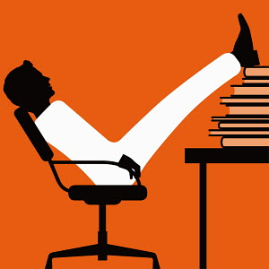 Businessman with feet up on stack of books