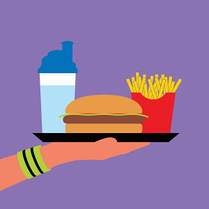 Hand wearing wristband holding fast food on tray