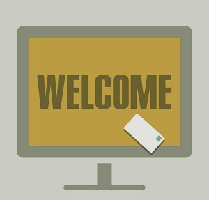 Welcome and email letter on computer monitor