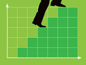 Businessman climbing bar chart stairs