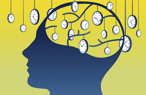 Man thinking about time with lots of clocks