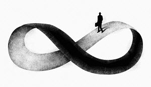 Businessman walking on infinity symbol
