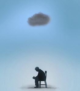 Man sitting under a black cloud