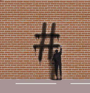 Graffiti artist spraying hashtag symbol on wall