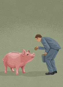 Businessman feeding money to piggy bank